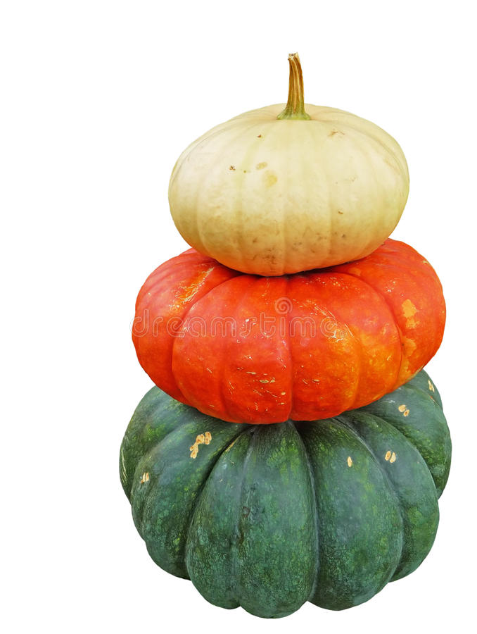 Three stacked pumpkins isolated on white