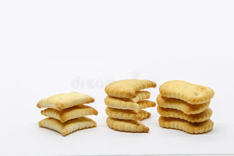 Three stacks of small crackers stock photography