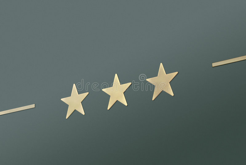 Three stars on green. Background stock photography
