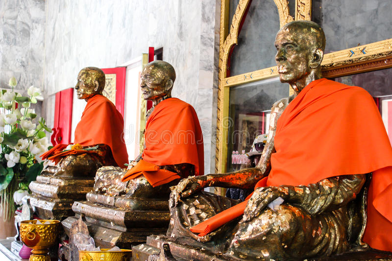 Three statues of famous monk stock photo