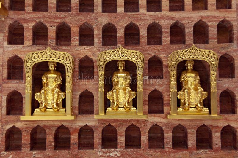 Ten thousand buddhist caves in the heaven of the god capital of the zhou dynasty in luoyang, China. Three statues of maitreya Buddha in the ten thousand Buddha royalty free stock image