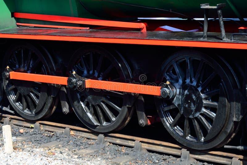Three steam train wheels stock photo