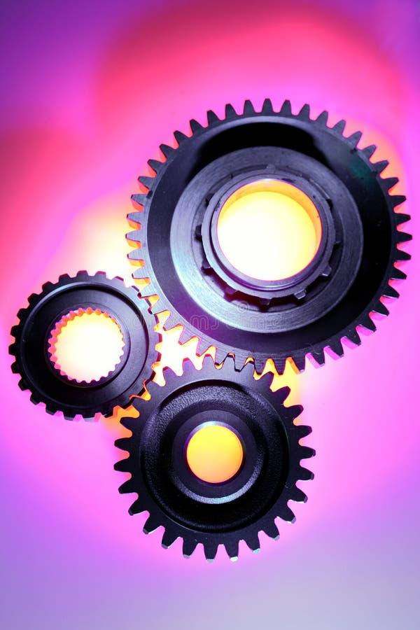 Three steel gears. Studio shot stock photos