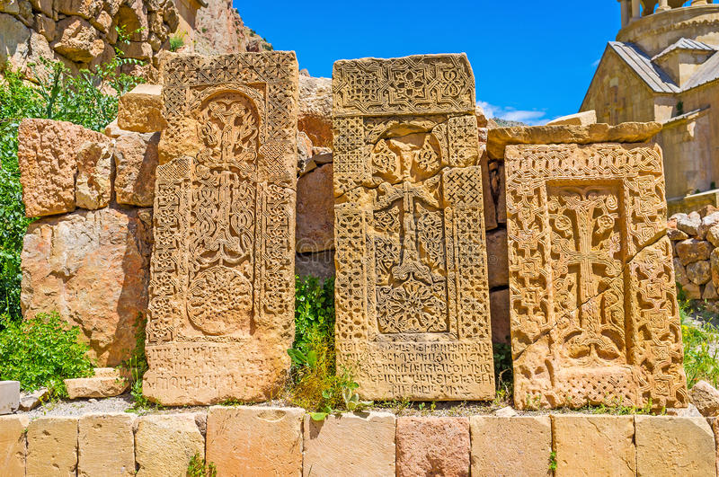 Three stone khachkars. The fine examples of the medieval religious art - the preserved stone khachkars with patterns, combining floral and geometric motives stock image