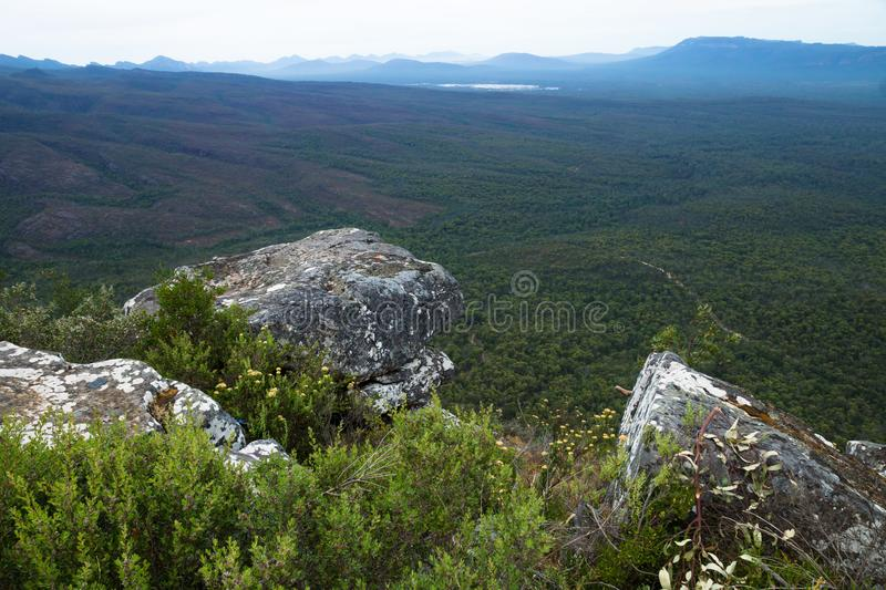 Three stones in front of view into the valley at Reeds Lookout, Grampians, Victoria, Australia. Three stones in front of view into the valley with blue mountains royalty free stock photos