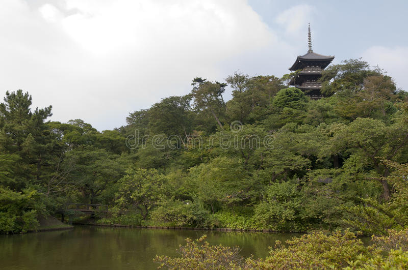 Three-storied in japaneese garden Sankei-en, Yokohama, Japan. Sankei-en's Main Pond with Three-storied Pagoda in the background royalty free stock image