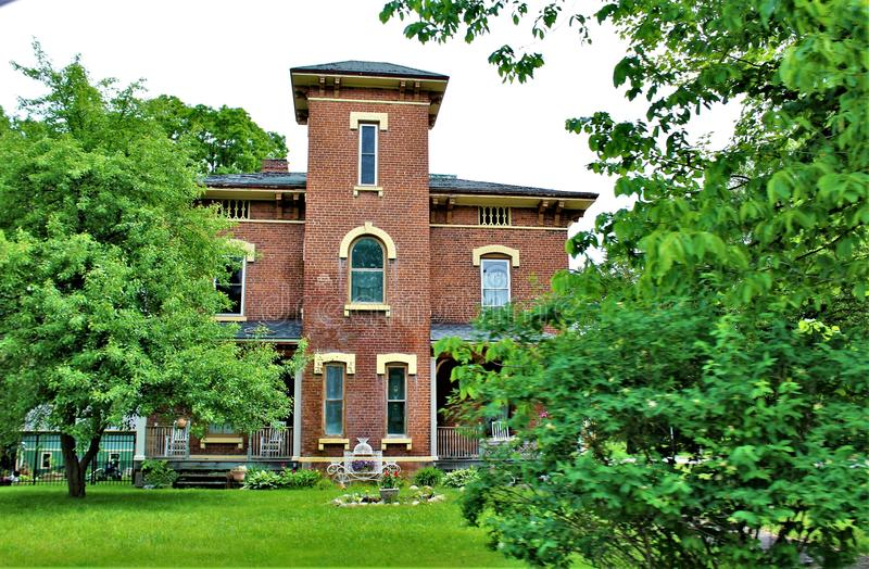 Victorian house in upstate Franklin County, New York, United States. Three story brick Victorian house located in upstate Franklin County, New York, in the royalty free stock images