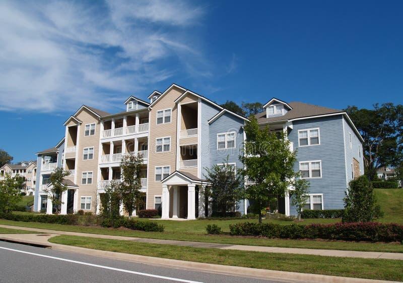 Three Story Condos, Apartments or TownhomesCondo,. Three story condos, apartments or townhomes with vinyl siding of blue and tan royalty free stock image
