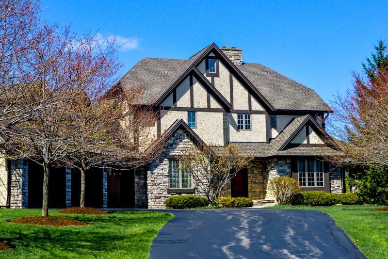 Three Story House with Blacktop Driveway. A beautiful three story home with a blacktop driveway in Lake Geneva, Wisconsin.  Three car garage.  Windows, brick stock photography