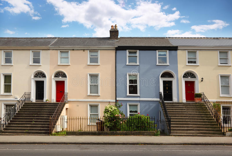 Three-story house stands beside road stock image