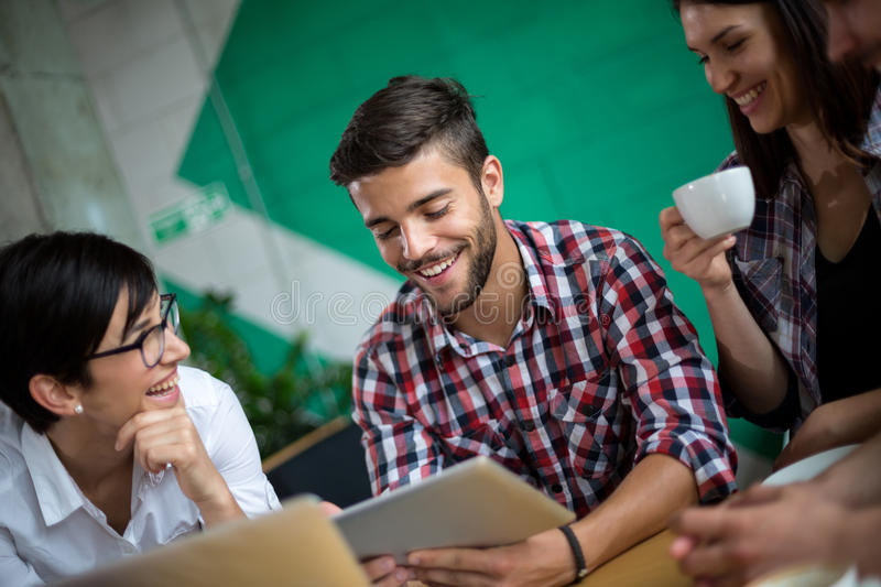 Three students studying on the tablet royalty free stock photos