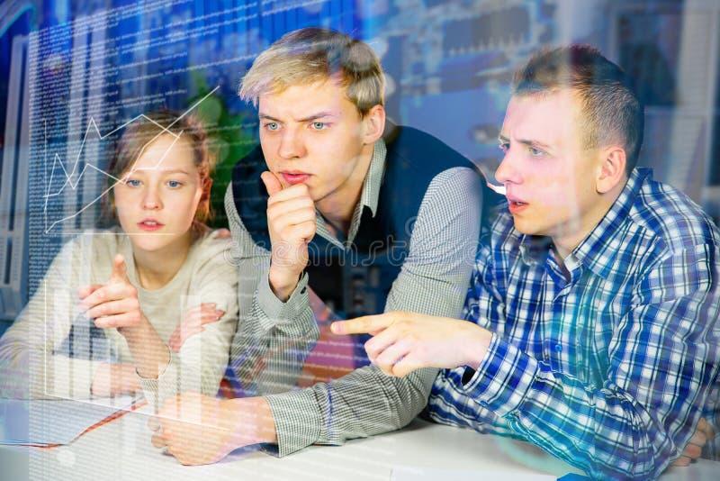 Three students work stock photo
