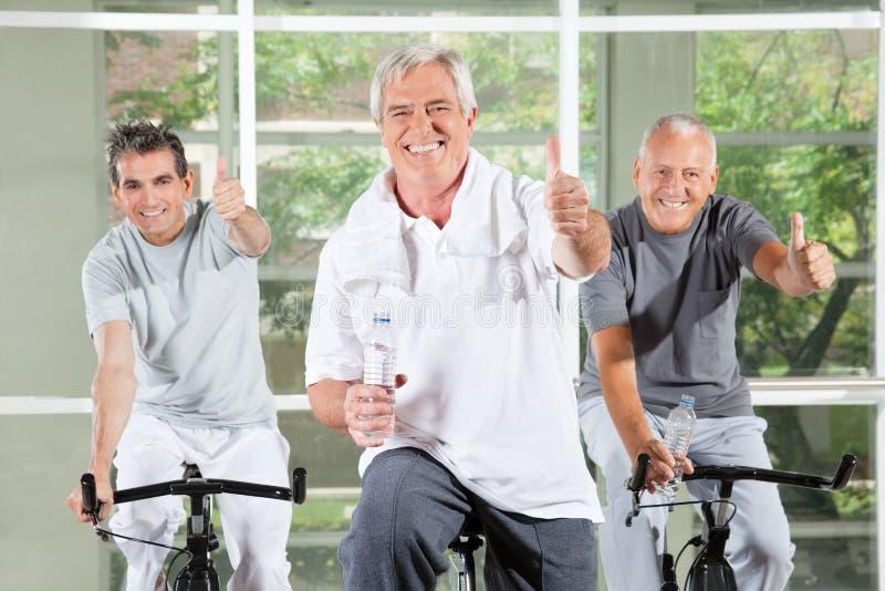 Three successful seniors holding stock photography