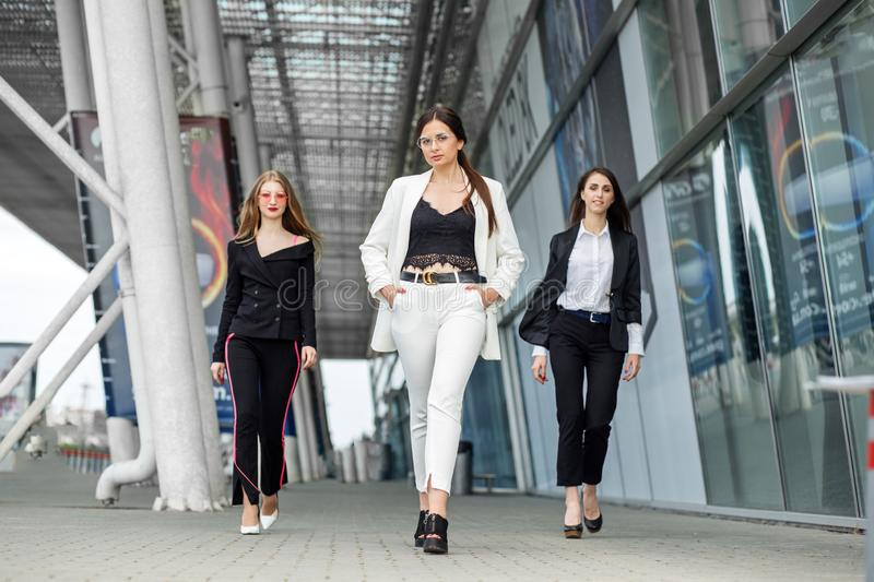 Three successful young women. Concept for business, boss, work and success stock image