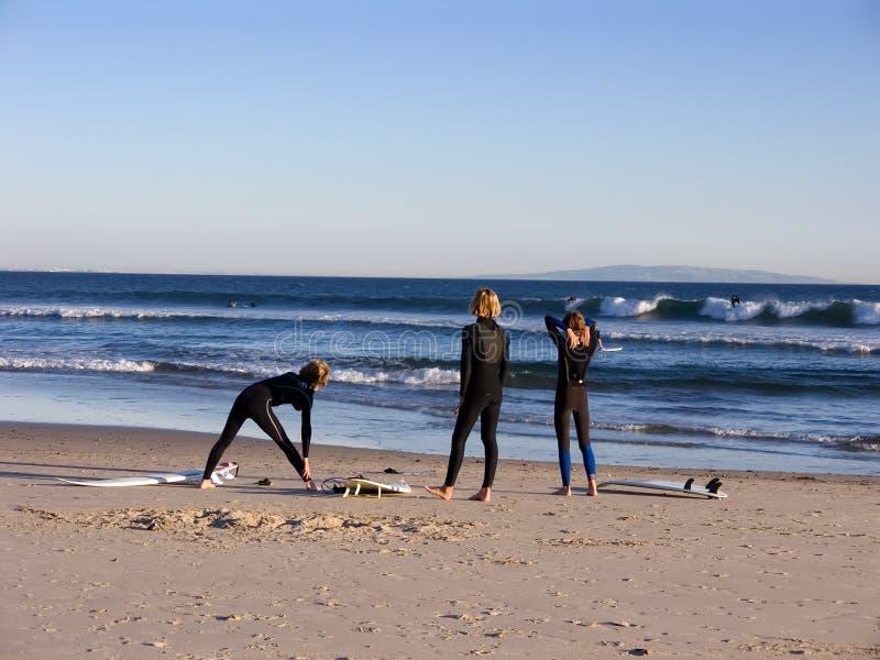 Three surfers royalty free stock photos