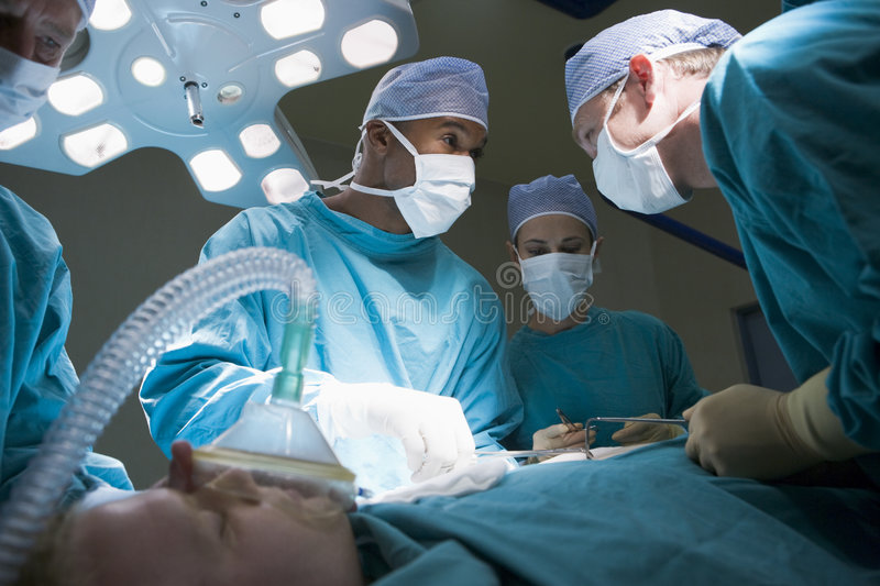 Three Surgeons Operating On A Patient royalty free stock photography