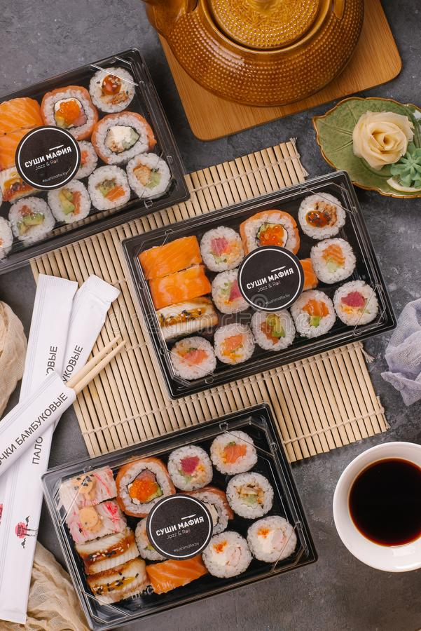 Three sushi on the table, top view. Multiple sushi dishes royalty free stock image