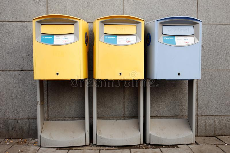 Three Swedish post boxes stock photography