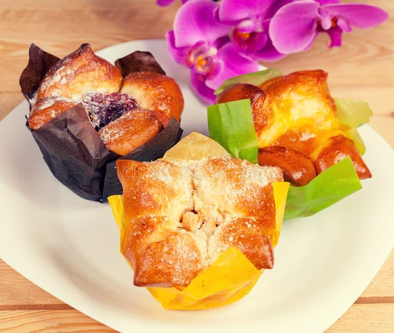 Three sweet buns with jam royalty free stock photo