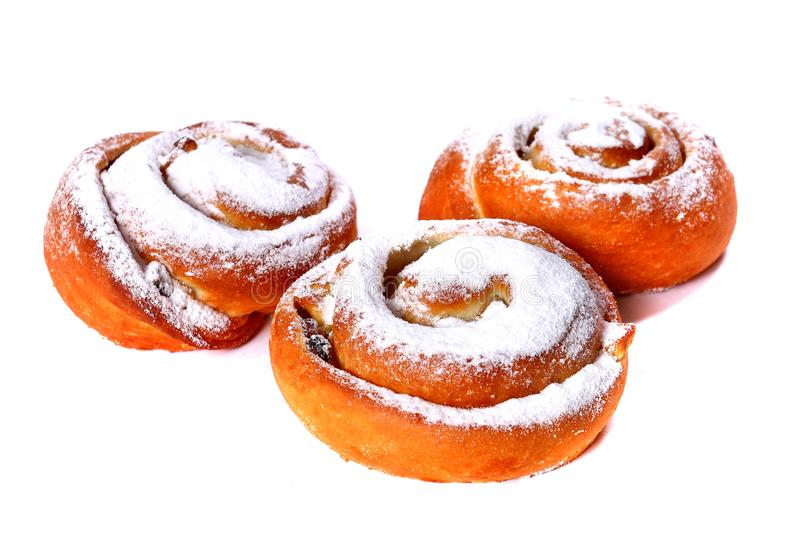 Three sweet buns with vanilla topping and raisins royalty free stock images