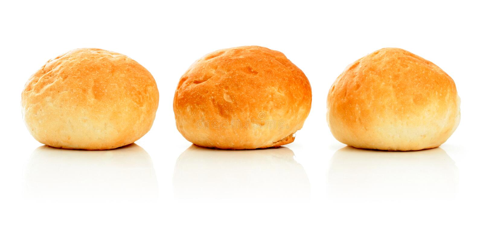 Three sweet buns on white stock images