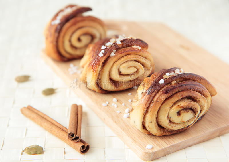 Three sweet rolls with cinnamon and cardamom royalty free stock photography