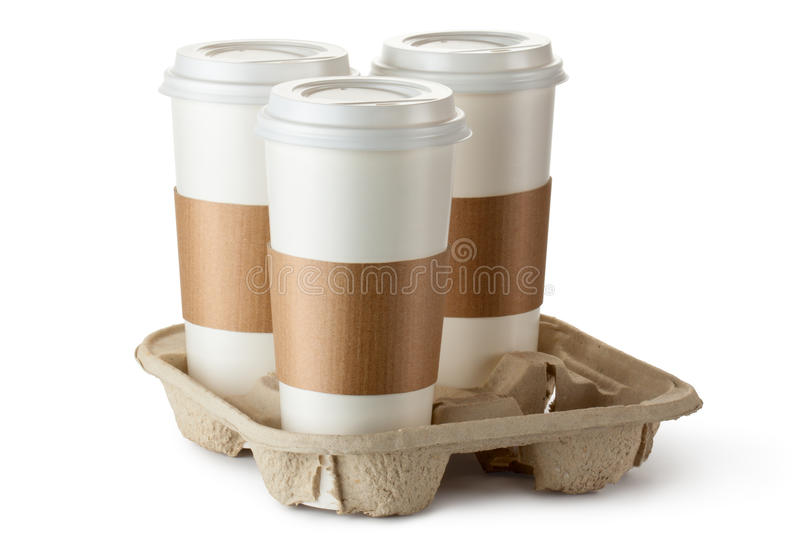 Three take-out coffee in holder royalty free stock images