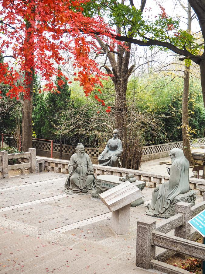 Three taoist stone sculptures in the courtyard of the Taiqing temple. Three taoist stone sculptures on the main courtyard of the Taiqing Temple or Temple of stock image