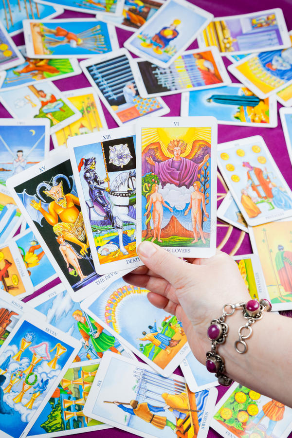Download Three Tarot Cards Held In Hand. Stock Photo - Image: 25093556