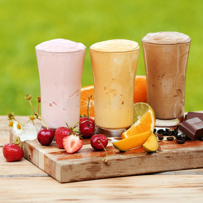 Three tasty various natural protein cocktails royalty free stock image