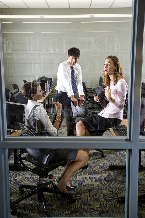 Three Teachers Meeting In Library Computer Room Stock Images