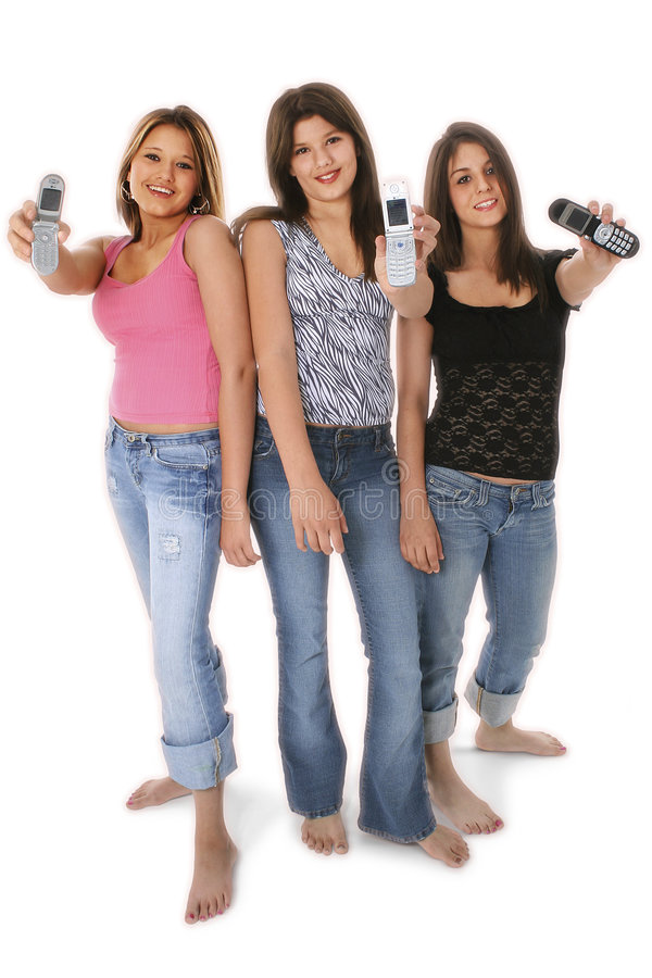 Three Teen Girls With Cellphones Over White royalty free stock photo