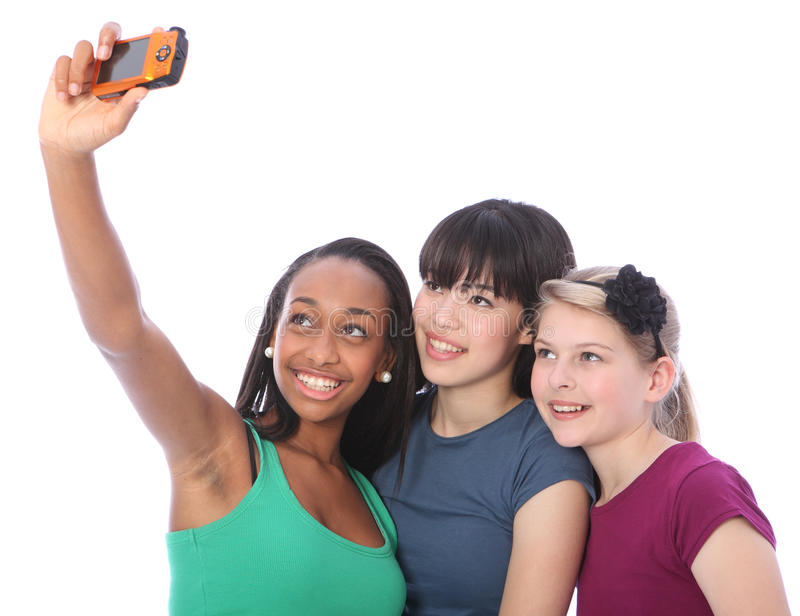 Three teenage girl friends fun with camera selfie stock images