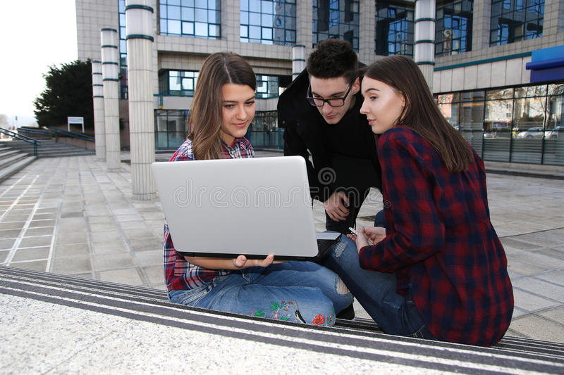 Three teenager students with laptop royalty free stock photos