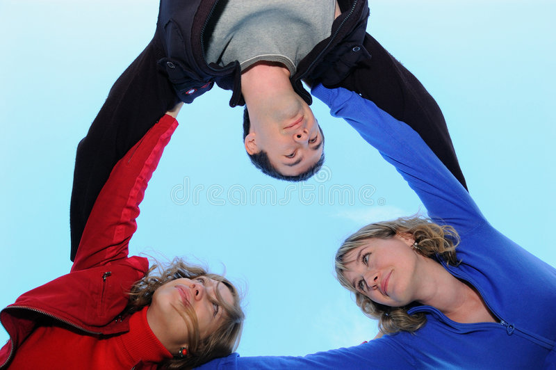 Three teenagers on the sky royalty free stock images