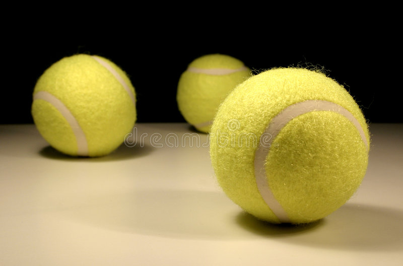 Three tennis-balls stock photo