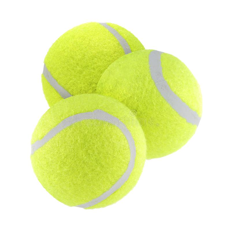 Three tennis balls isolated on white background with clipping path stock photo