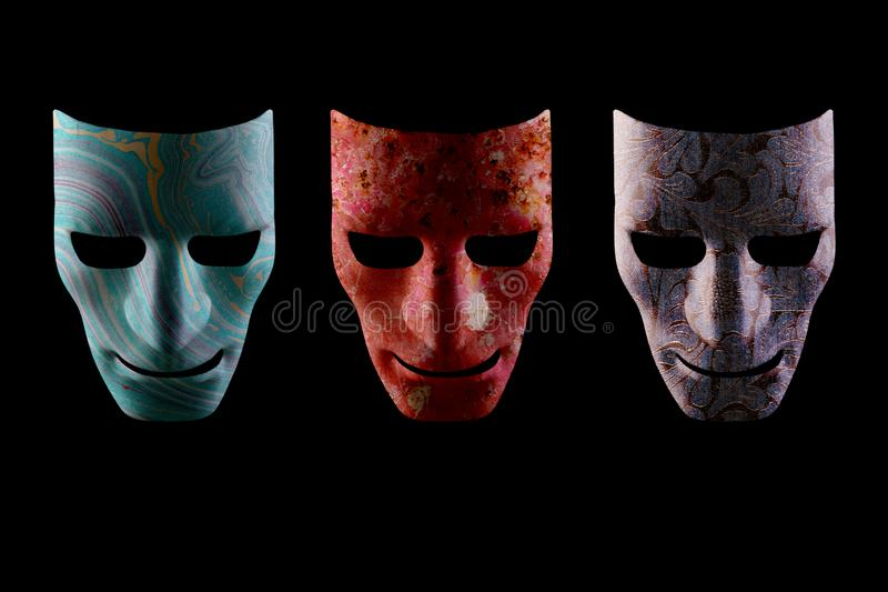 Three textured AI robotic face masks. Three face masks with different textures on a black background. Artificial intelligence robotic faces royalty free stock images