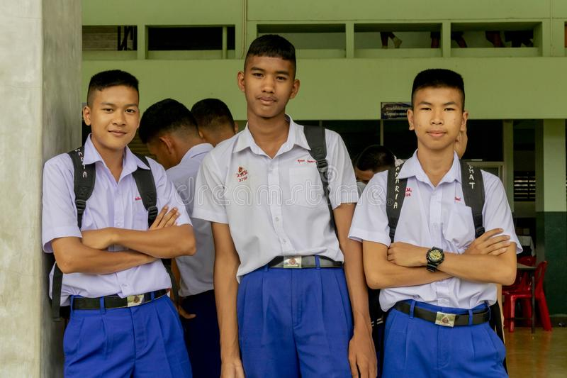 Three Thai students in their school uniform is standing by each other to the camera in Wanthamaria school Pranburi, Thailand stock photos