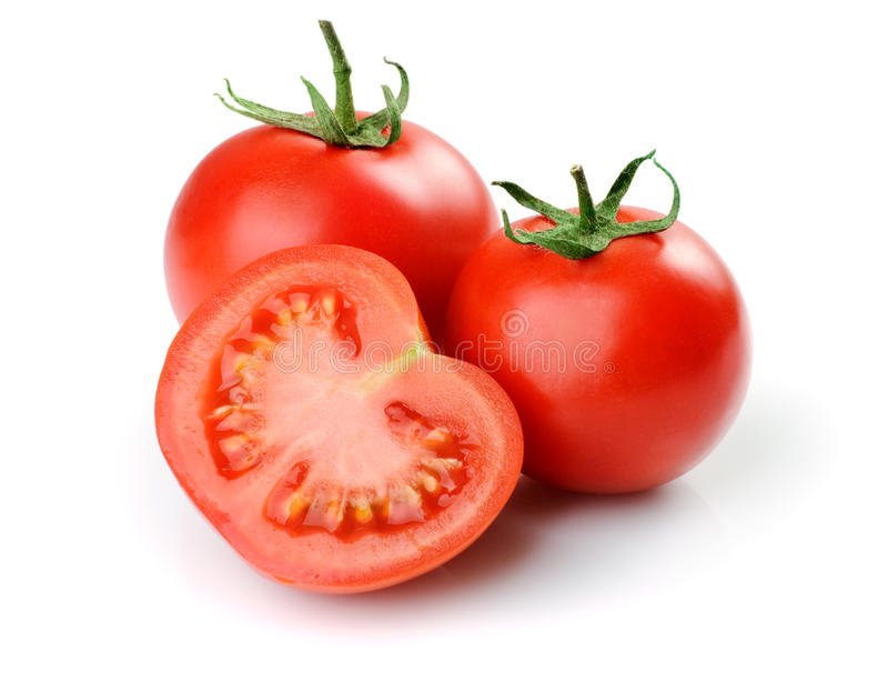 Three tomatoes. Two whole tomatoes and one half. Isolated on white background