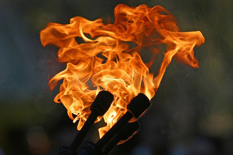 Three Torches. Burning against a dark background royalty free stock images