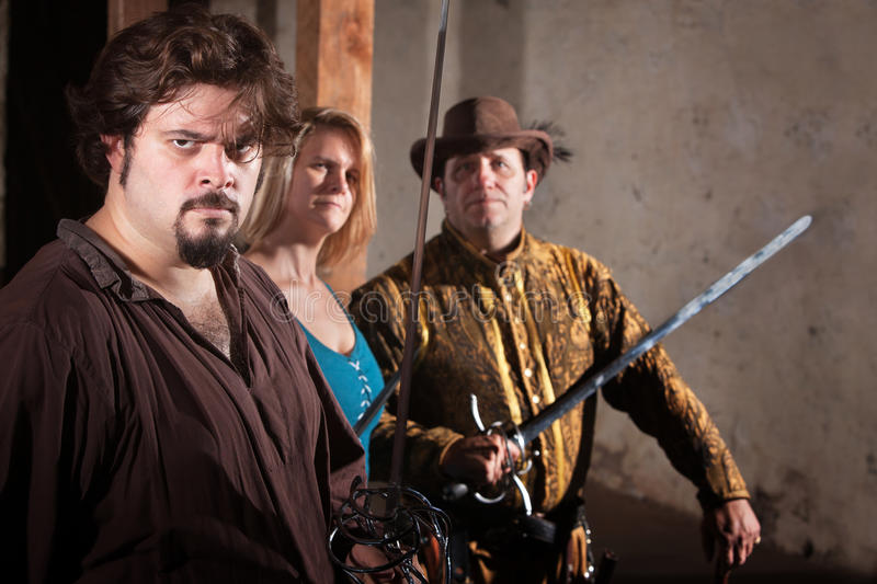 Three Sword Fighters in Dungeon. Three tough sword fighters in a dungeon royalty free stock image
