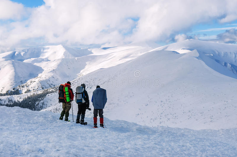 Three tourists,winter royalty free stock photography