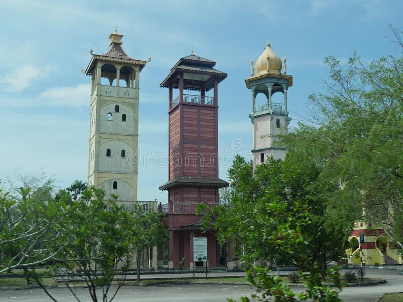 Three towers stand side by side near the Melaka Gateway Arch in Melaca, Malaysia to represent the three major races in the country stock image