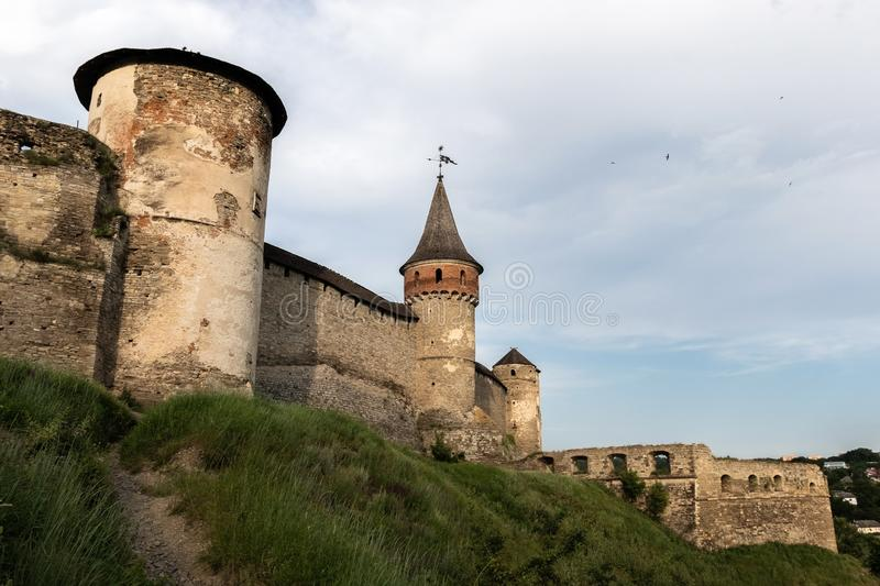 Three towers and stone walls of the medieval fortress of the XVI century in the city of Kamianets-Podilskyi. royalty free stock photos