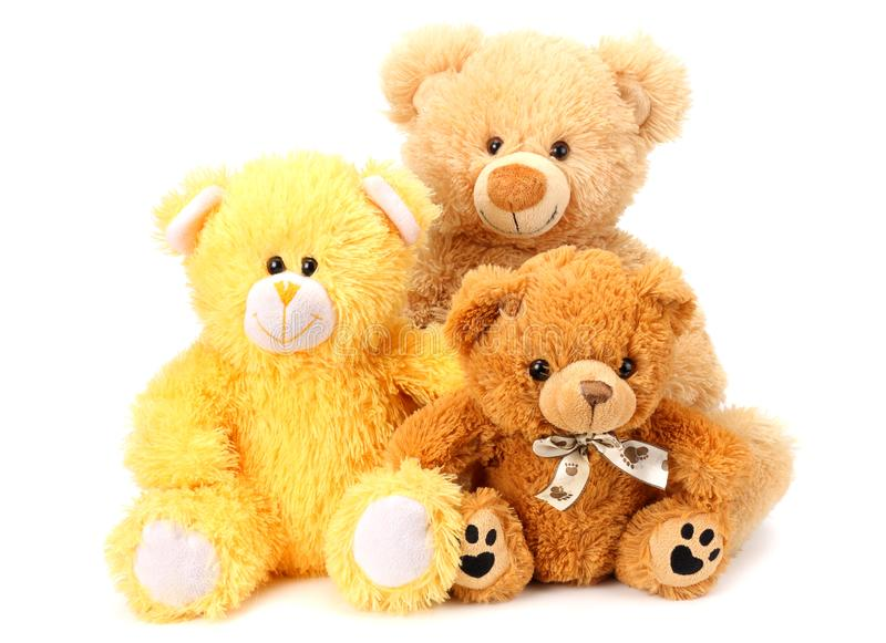 Three toy teddy bears isolated on white background stock photo