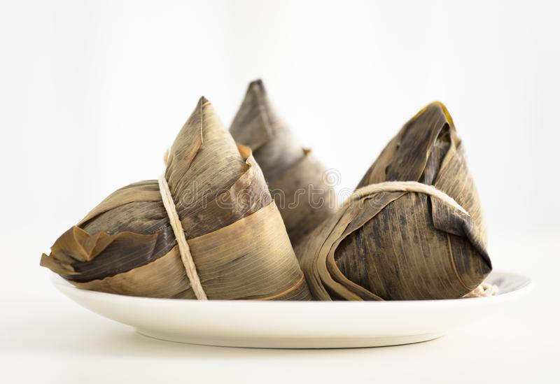 Three traditional rice dumplings on table stock images