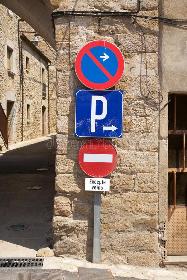 Three traffic signs. Detail of street at a village in Girona Catalonia Spain royalty free stock photos