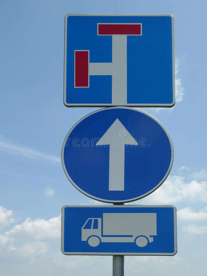 Three traffic signs - dead end, one way, truck. With blue sky background stock photo