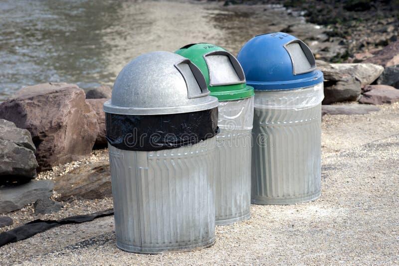 Three trash cans stock photos